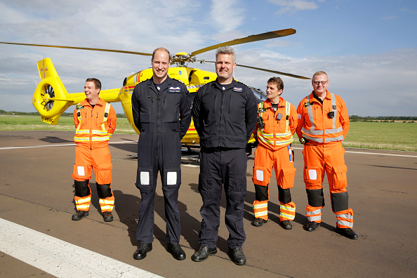CAMBRIDGE, ENGLAND - JULY 27: Prince William, Duke of Cambridge (2L) starts his final shift with the East Anglian Air Ambulance based out of Marshall Airport on July 27, 2017 near Cambridge, England. (Photo by Heathcliff O'Malley - WPA Pool/Getty Images)