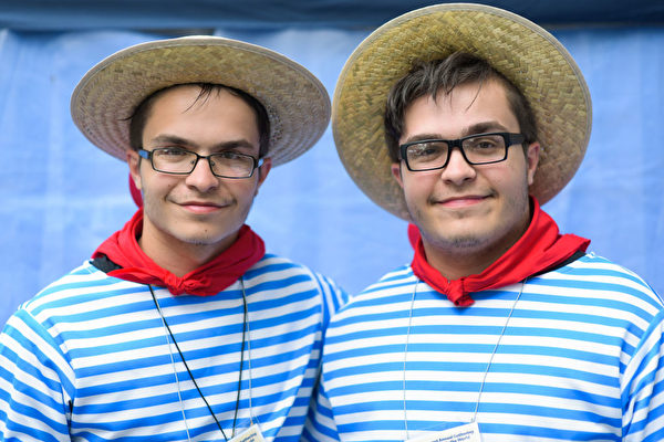 Samuel Muscatto, left, and identical twin brother Joseph, both 18 from Buffalo, pose for a portrait during the Twins Days Festival in Twinsburg, Ohio, on August 5, 2017. The Twins Days Festival is the world's largest gathering of twins and multiples and celebrates its 42nd year. / AFP PHOTO / Dustin Franz (Photo credit should read DUSTIN FRANZ/AFP/Getty Images)