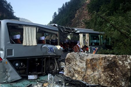 A tour bus damaged during an earthquake is seen in Jiuzhaigou in China's southwestern Sichuan province on August 9, 2017. At least 12 people were killed when a 6.5-magnitude earthquake struck southwestern China, government sources said on August 9, but the toll was expected to climb as news trickles out of the remote mountainous region. / AFP PHOTO / STR / China OUT (Photo credit should read STR/AFP/Getty Images)