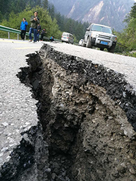 A crack, caused by an earthquake, is seen on a road in Jiuzhaigou in China's southwestern Sichuan province on August 9, 2017. At least 12 people were killed when a 6.5-magnitude earthquake struck southwestern China, government sources said on August 9, but the toll was expected to climb as news trickles out of the remote mountainous region. / AFP PHOTO / STR / China OUT (Photo credit should read STR/AFP/Getty Images)
