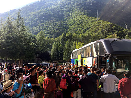 Tourists wait to be evacuated after an earthquake in Jiuzhaigou in China's southwestern Sichuan province on August 9, 2017. China on August 9 evacuated tens of thousands people in its mountainous southwest after a strong earthquake killed at least 19 people and rattled a region where memories of a 2008 seismic disaster remain fresh. / AFP PHOTO / STR / China OUT (Photo credit should read STR/AFP/Getty Images)
