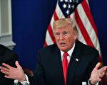 """星期五下午,川普告诉媒体记者,如果金正恩威胁或攻击美国领土或盟友,美国会让他""""很快就后悔""""。(NICHOLAS KAMM/AFP/Getty Images)"""