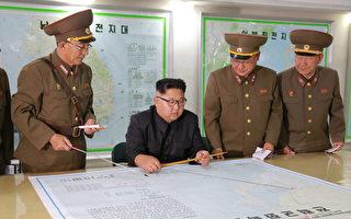 """据朝鲜高层情报人士透露,金正恩害怕在美国万一发动对朝鲜进行军事袭击时对自己进行""""斩首"""",早就安排下了逃跑到中国的计划。 (STR/AFP/Getty Images)"""
