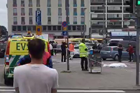 """A video grab taken from the Twitter account of Juha Riihimaki on August 18, 2017 shows officials standing in a street in the Finnish city of Turku where several people were stabbed. """"Police shot the suspected perpetrator in the legs,"""" police wrote on Twitter. """"The person has been arrested. We recommend that people avoid central Turku / AFP PHOTO / Juha Riihimaki (Photo credit should read JUHA RIIHIMAKI/AFP/Getty Images)"""