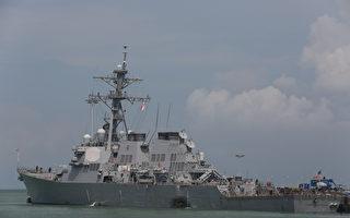 在约翰•麦凯恩号驱逐舰跟商船发生碰撞事故之后,美国海军周四(8月24日)将重点从搜寻10名失踪人员转向修复工作。海军认为,他们已经没有生还希望。 (U.S. Navy photo by Grady T. Fontana/U.S. Navy via Getty Images)