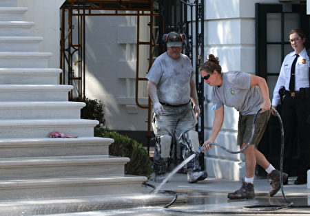 WASHINGTON, DC - AUGUST 22: A member of the National Park Service washes the new South Portico steps of the White House August 22, 2017 in Washington, DC. The White House has undergone a major renovation with an upgrade of the HVAC system at the West Wing, the South Portico steps, the Navy mess kitchen, and the lower lobby. (Photo by Alex Wong/Getty Images)