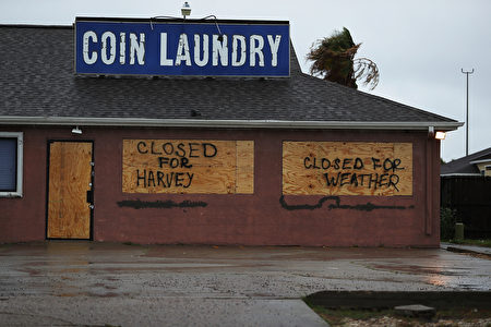 CORPUS CHRISTI, TX - AUGUST 25: A sign on a business reads, 'Closed for Harvey', as people prepare for approaching Hurricane Harvey on August 25, 2017 in Corpus Christi, Texas. Hurricane Harvey has intensified into a hurricane and is aiming for the Texas coast with the potential for up to 3 feet of rain and 125 mph winds. (Photo by Joe Raedle/Getty Images)