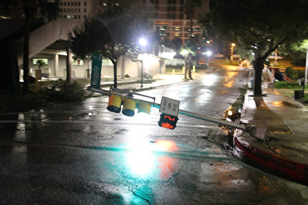 CORPUS CHRISTI, TX - AUGUST 26: A street light is knocked off it's base by the winds of Hurricane Harvey on August 26, 2017 in Corpus Christi, Texas. Hurricane Harvey had intensified into a hurricane and hit the Texas coast as damage is being assessed. (Photo by Joe Raedle/Getty Images)
