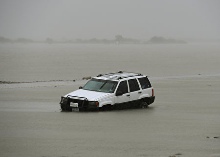A car lies submerged after Hurricane Harvey hit Corpus Christi, Texas on August 26, 2017. Hurricane Harvey hit the Texas coast with forecasters saying its possible for up to 3 feet of rain and 125 mph winds. Hurricane Harvey slammed into the Texas coast late Friday, unleashing torrents of rain and packing powerful winds, the first major storm to hit the US mainland in 12 years. / AFP PHOTO / MARK RALSTON (Photo credit should read MARK RALSTON/AFP/Getty Images)