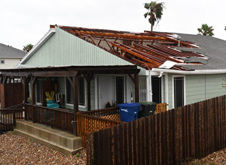 A house suffers roof damage after Hurricane Harvey hit Corpus Christi, Texas on August 26, 2017. Hurricane Harvey slammed into the Texas coast late Friday, unleashing torrents of rain and packing powerful winds, the first major storm to hit the US mainland in 12 years. / AFP PHOTO / MARK RALSTON (Photo credit should read MARK RALSTON/AFP/Getty Images)