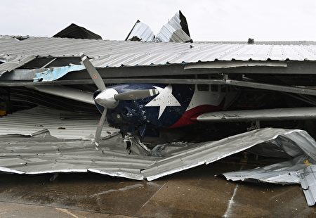 A badly damaged light plane in its hanger at Rockport Airport after heavy damage when Hurricane Harvey hit Rockport, Texas on August 26, 2017. Hurricane Harvey slammed into the Texas coast late Friday, unleashing torrents of rain and packing powerful winds, the first major storm to hit the US mainland in 12 years. / AFP PHOTO / MARK RALSTON (Photo credit should read MARK RALSTON/AFP/Getty Images)