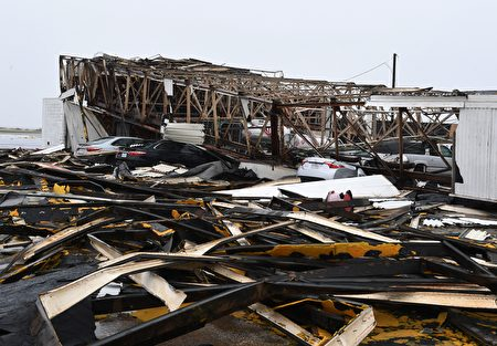 A destroyed building at Rockport Airport after heavy damage when Hurricane Harvey hit Rockport, Texas on August 26, 2017. Hurricane Harvey left a trail of devastation Saturday after the most powerful storm to hit the US mainland in over a decade slammed into Texas, destroying homes, severing power supplies and forcing tens of thousands of residents to flee. / AFP PHOTO / MARK RALSTON (Photo credit should read MARK RALSTON/AFP/Getty Images)