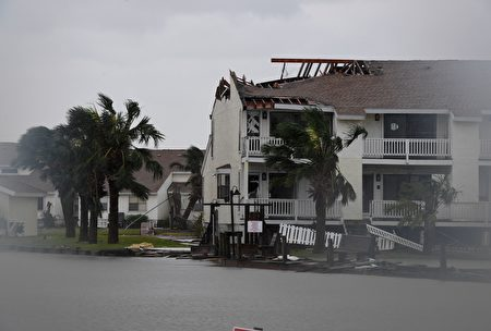 The badly damaged Fulton Beach Resort after Hurricane Harvey hit Rockport, Texas on August 26, 2017. Hurricane Harvey left a trail of devastation Saturday after the most powerful storm to hit the US mainland in over a decade slammed into Texas, destroying homes, severing power supplies and forcing tens of thousands of residents to flee. / AFP PHOTO / MARK RALSTON (Photo credit should read MARK RALSTON/AFP/Getty Images)