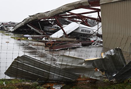 Badly damaged light planes in their hanger at Rockport Airport after heavy damage when Hurricane Harvey hit Rockport, Texas on August 26, 2017. Hurricane Harvey left a trail of devastation Saturday after the most powerful storm to hit the US mainland in over a decade slammed into Texas, destroying homes, severing power supplies and forcing tens of thousands of residents to flee. / AFP PHOTO / MARK RALSTON (Photo credit should read MARK RALSTON/AFP/Getty Images)