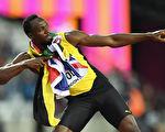 "牙买加""闪电""博尔特(Usain Bolt)庆祝胜利的招牌动作。 (Matthias Hangst/Getty Images)"