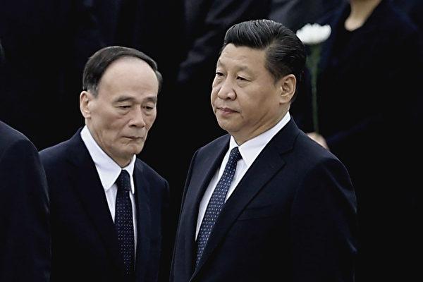 8月4日、5日,连续两家家外媒认为,王岐山将留任,习近平可能连任三届。 ( Feng Li/Getty Images)