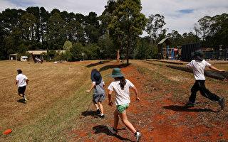 Don Bosco Catholic Primary School天主教小學召開緊急大會宣布,禁止五年級和六年級的男女學生在操場一起玩耍。(Michael Dodge/Getty Images)