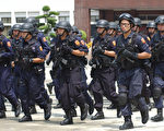 扩大追查幕后分子外,近期将执行双北地区联合扫黑,打击帮派据点。(AFP)