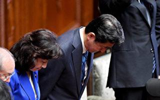 日本首相安倍晋三(中)28日正式宣布解散国会,以便提前大选争取连任。(TOSHIFUMI KITAMURA/AFP/Getty Images)