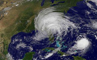 2017年9月11日衛星圖像顯示颶風Jose(下右)和熱帶風暴艾瑪(中)。(AFP PHOTO / NASA/GOES Project)