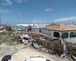 安巴國房屋遭到颶風艾瑪嚴重損毀。( AFP PHOTO / Gemma HANDY)