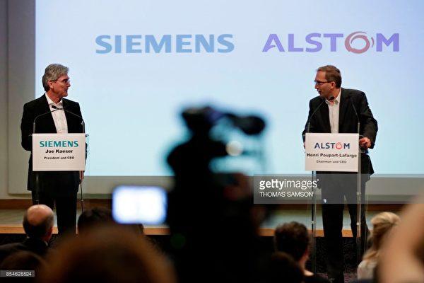 德國西門子公司與法國阿爾斯通合併鐵路業務。9月27日,兩家公司的首席執行官在巴黎舉辦發布會。(AFP提供)