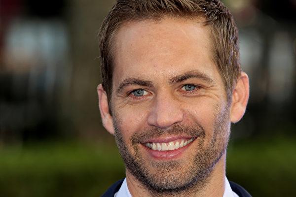 2013年,保罗在伦敦参加《玩命关头6》的首映礼。(Tim P. Whitby/Getty Images)