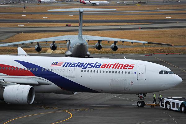 2014年3月8日,马来西亚航空公司由吉隆+坡飞往北京的MH370航班在起飞一小时后,在越南上空突然消失。(Photo by Greg Wood - Pool/Getty Images)
