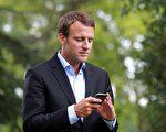 近日,一名記者的手機被盜後,法國總統馬克龍的一個私人電話號碼就在互聯網上被傳播開來。(NICOLAS TUCAT/AFP/Getty Images)