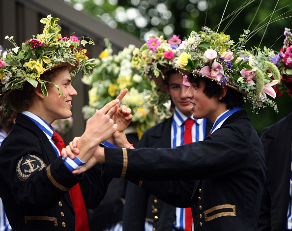 WINDSOR, UNITED KINGDOM - JUNE 2008: Members of one of Eton's rowing eights sport naval uniforms and hats decorated with flowers prior to the Procession of Boats as part of the June 4th celebrations, at the iconic private school near Windsor, England. The annual celebrations mark the start of the Summer half-term break, and traditionally showcase the variety of activities undertaken at the school as well as being a prominent date in the summer social season in England. The traditional day of celebration of June 4th is also the birthday of King George III. In addition to the historic procession of boats, where pupils dress in tradition naval attire and decorate their hats with flowers, speeches and displays are put on for parents and visitors. (Photo by Christopher Furlong/Getty Images)