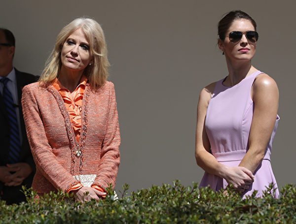 WASHINGTON, DC - APRIL 05: White House Senior Advisor, Kellyanne Conway (L), stand with White House Communications Director, Hope Hicks, during a news conference with U.S. President Donald Trump and King Abdullah II of Jordan, at the White House April 5, 2017 in Washington, DC. President Trump held talks on Middle East peace process and other bilateral issues with King Abdullah II. (Photo by Mark Wilson/Getty Images)