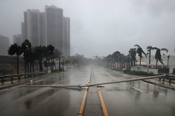 FORT LAUDERDALE, FL - SEPTEMBER 10: East Oakland Park Boulevard is completely blocked by a downed street light pole as Hurricane Irma hits the southern part of the state September 10, 2017 in Fort Lauderdale, Florida. The powerful hurricane made landfall in the United States in the Florida Keys at 9:10 a.m. after raking across the north coast of Cuba. (Photo by Chip Somodevilla/Getty Images)
