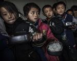 中共统治的中国农村半数以上的孩子智商发育晚(Photo by Kevin Frayer/Getty Images)