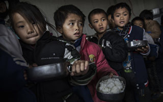 中共統治的中國農村半數以上的孩子智商發育晚(Photo by Kevin Frayer/Getty Images)