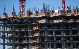 图说:温哥华市正在兴建中的一栋公寓楼。(加通社)