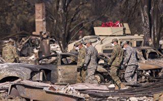 加州史上最嚴重的山林大火造成的死亡人數上升到至少40人。圖為2017年10月14日,加州聖羅莎,救難人員正在火災現場進行搜救。(David McNew/Getty Images)