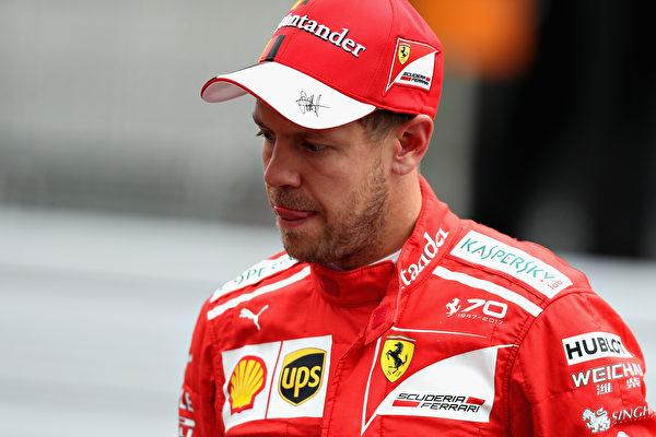 法拉利车手维特尔因赛车出现故障,在第五圈早早退赛。(Mark Thompson/Getty Images)