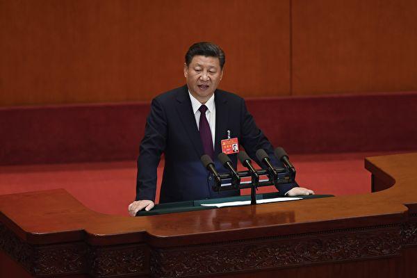 十九大18日召開,中國最高領導人習近平在開幕式上發表工作報告,罕見地把「民主」擺在第一位。(AFP)