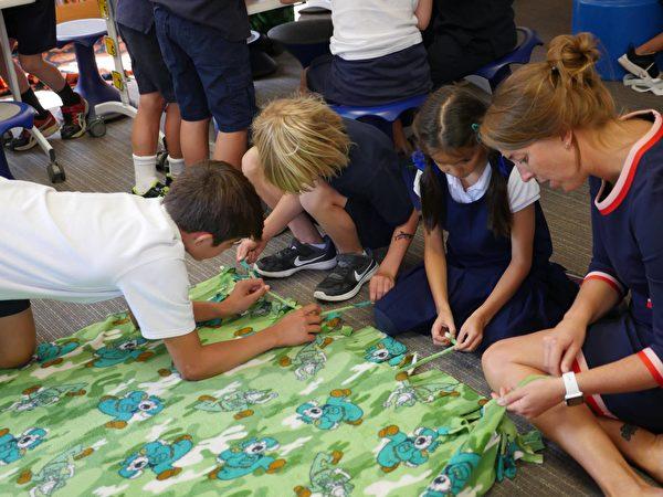 学生们制作毛毯送给需要的孩子与家庭。(著名湾区私校Hillbrook(K-8)提供)