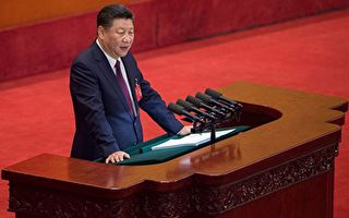 """(FILES) This file photo taken on October 18, 2017 shows China's President Xi Jinping delivering a speech at the opening session of the Chinese Communist Party's Congress at the Great Hall of the People in Beijing. When Chinese President Xi Jinping warned against """"pleasure seeking"""" in a stern message to the Communist Party congress last week, the audience included few women and some notable absentees -- officials ousted by graft scandals involving illicit affairs. / AFP PHOTO / Nicolas ASFOURI"""