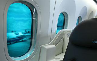 """波音787梦幻客机可调光的""""电子窗户""""也是圆形的。(Chris McGrath/Getty Images)"""
