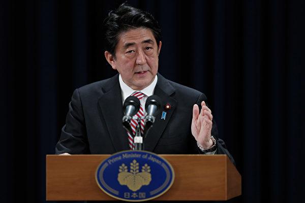 週日(10月22日)的出口民調顯示,在全國大選中,日本選民將首相安倍晉三的執政聯盟推回權力寶座。  (Lintao Zhang/Getty Images)