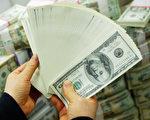 白宫星期一(10月16日)发布分析报告说,公司税率从35%降至20%,据最保守估计,美国家庭的年均收入将增加4,000美元,乐观估计则超过9,000美元。(Chung Sung-Jun/Getty Images)