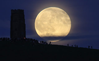 GLASTONBURY, ENGLAND - JUNE 20:  A full moon rises behind Glastonbury Tor as people gather to celebrate the summer solstice on June 20, 2016 in Somerset, England. Tonight's strawberry moon, a name given to the full moon in June by Native Americans because it marks the beginning of strawberry picking season, last occurred on the solstice on June 22, 1967 and it will not happen again on the summer solstice for another 46 years until June 21, 2062.  (Photo by Matt Cardy/Getty Images)