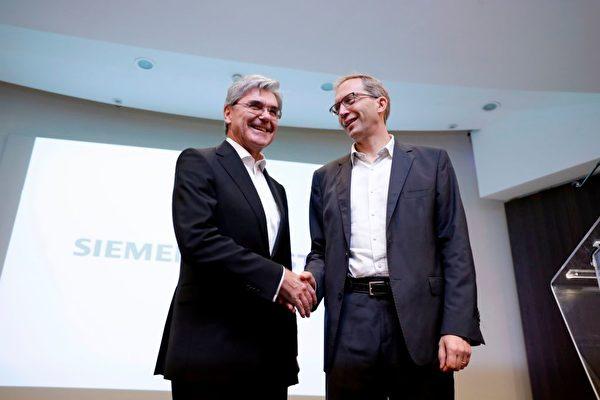 德國西門子公司與法國阿爾斯通合併鐵路業務。9月27日,西門子股份公司總裁兼首席執行官凱颯(左)和阿爾斯通首席執行官布爾芭-拉法基(右)在巴黎舉辦發布會。(THOMAS SAMSON/AFP/Getty Images)