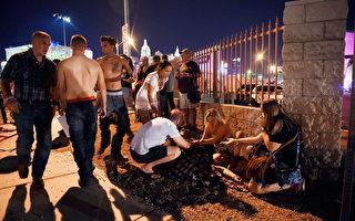 0月1日晚,美国赌城拉斯维加斯发生美国近代史上最致命枪击血案,在目击者回顾当时惊恐一刻时,现场也涌出舍身为陌生人挡子弹的勇士。(David Becker/Getty Images)