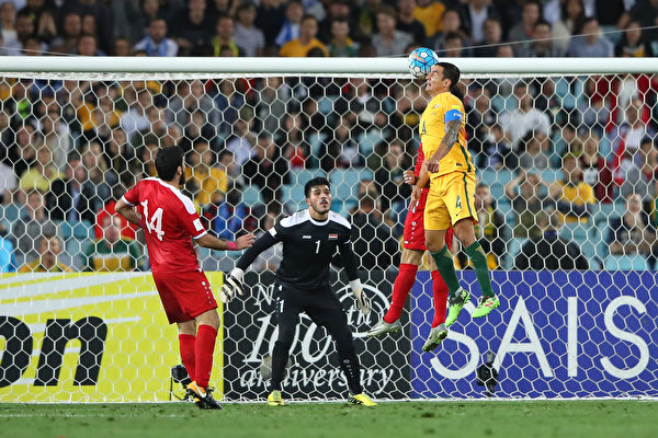 SYDNEY, AUSTRALIA - OCTOBER 10: Tim Cahill of Australia scores a goal during the 2018 FIFA World Cup Asian Playoff match between the Australian Socceroos and Syria at ANZ Stadium on October 10, 2017 in Sydney, Australia. (Photo by Cameron Spencer/Getty Images)