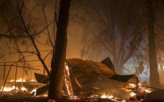 美国加州索诺马县山区野火延烧至今已造成34人死亡、数百人失踪,由于气象局预测又有强风降临,当局于10月14日再度强制撤离数千人。(David McNew/Getty Images)