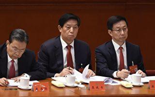 栗戰書(中),趙樂際(左一)在中共十九大開幕上。(WANG ZHAO/AFP/Getty Images)