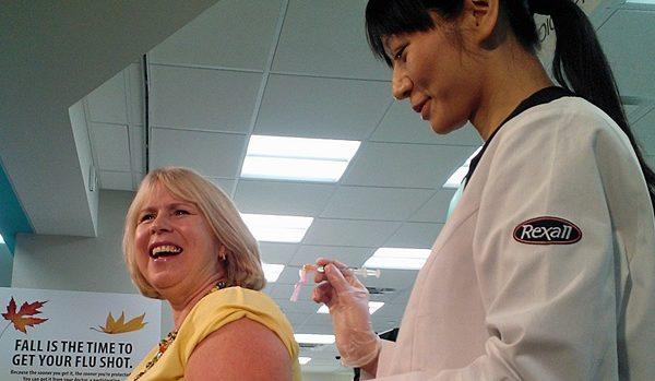 及时注射流感疫苗,保护自己和家人健康。(加通社)